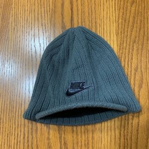 Nike beanie with small bill. Grey in color.